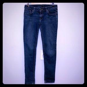 Michael Kors blue jeans.